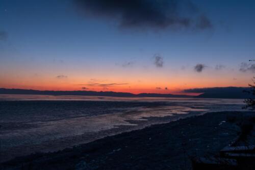 Baikal late at night at sunset in winter