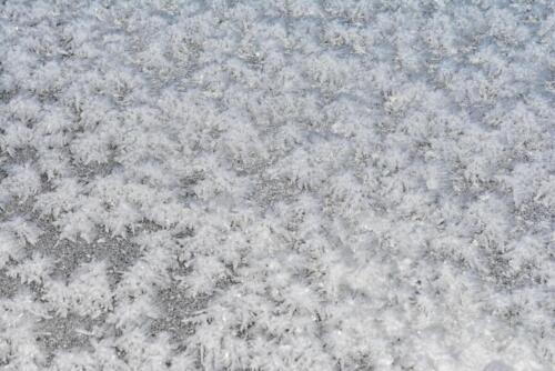 Фон снежинки на льду